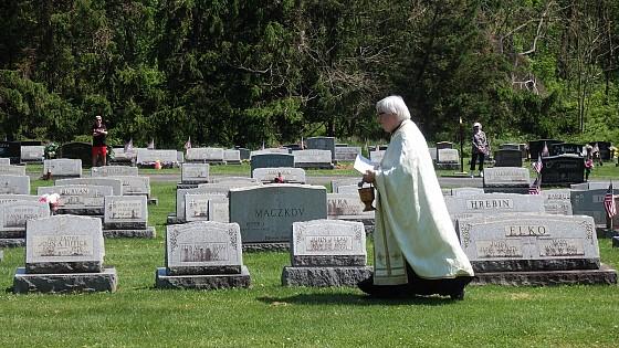 Reverend Jerome Botsko blessing Cemetery